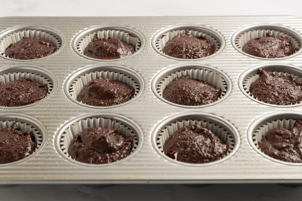 chocolate batter in muffin cups