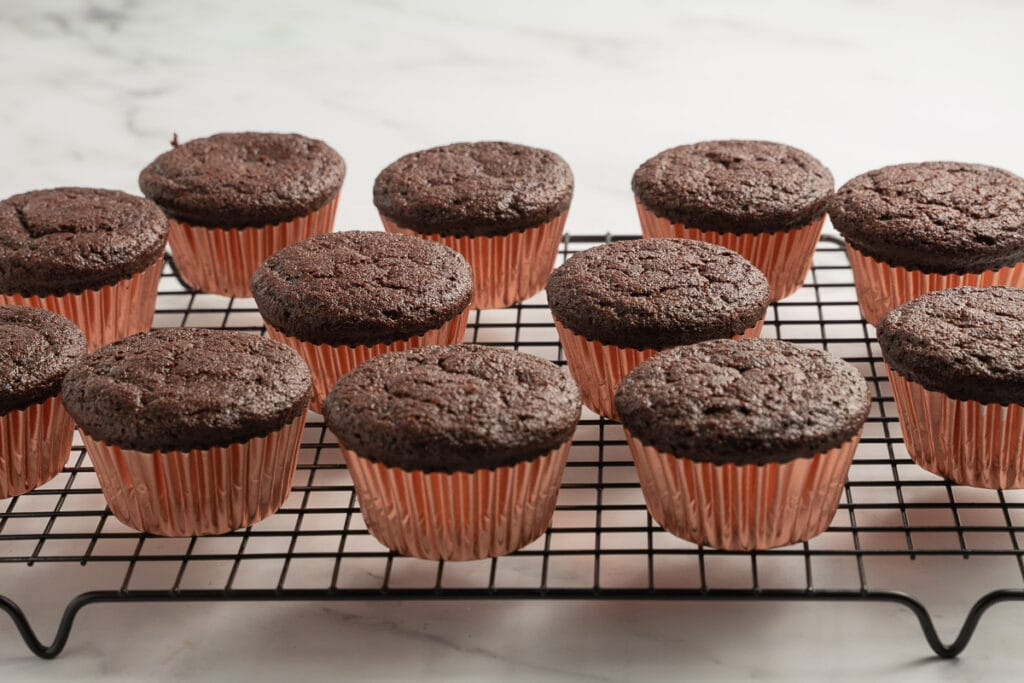 chocolate cupcakes on cooking rack