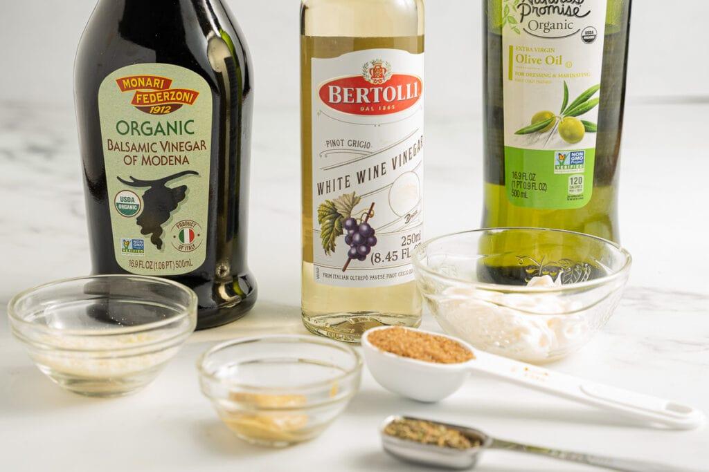 olive oil, balsamic vinegar, rice wine vinegar, seasonings, garlic cloves