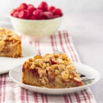 slice of keto almond cherry cake, bowl of cherries