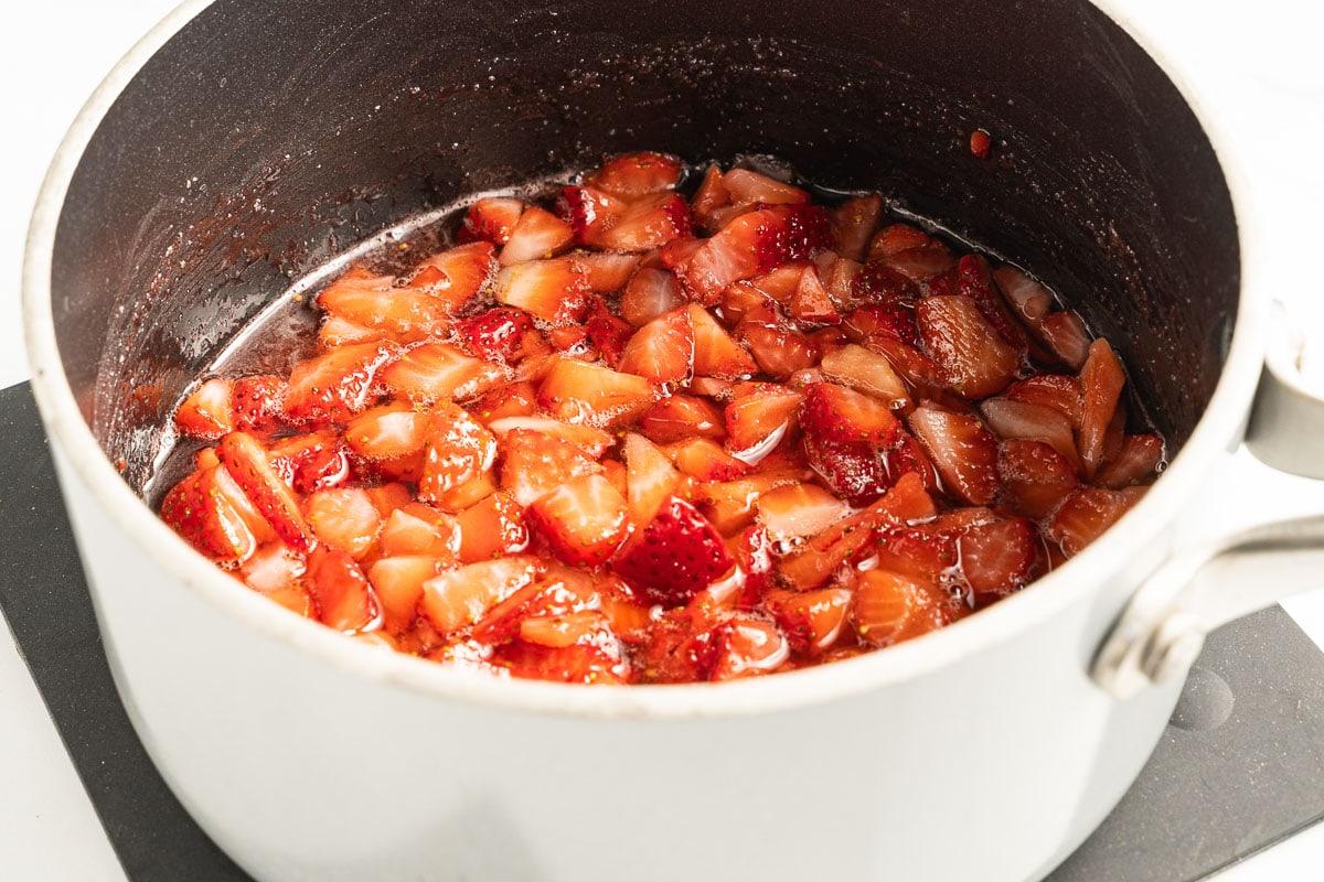 sliced strawberries, sugar, lemon juice in saucepan