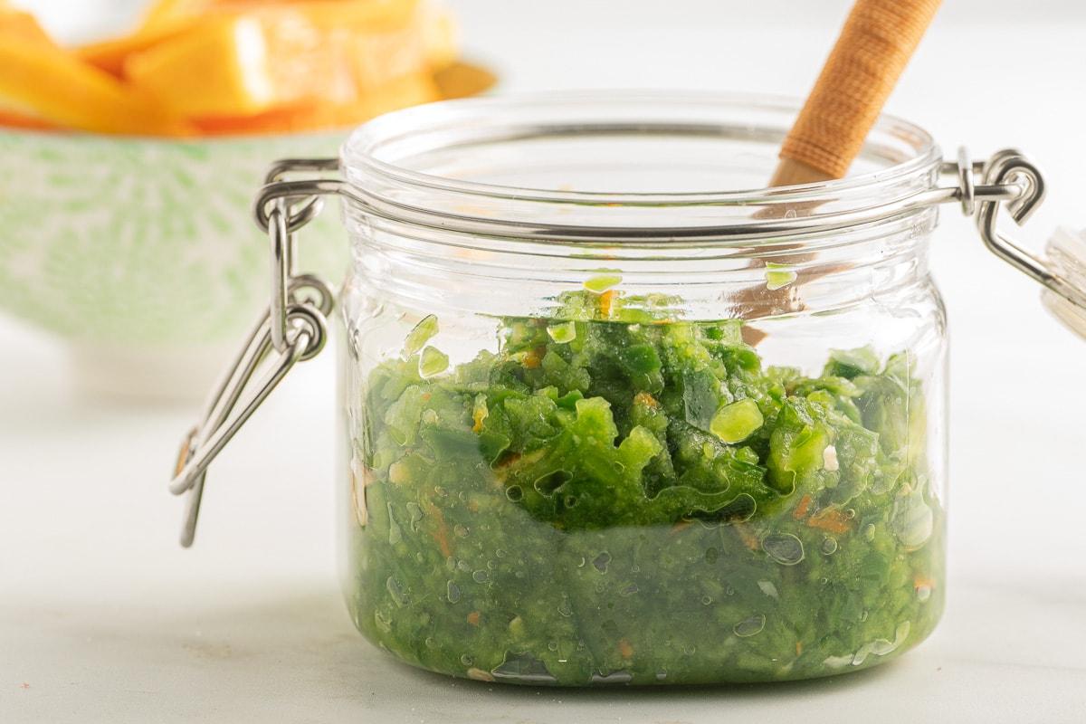Jalapeno orange relish in jar with mini spoon