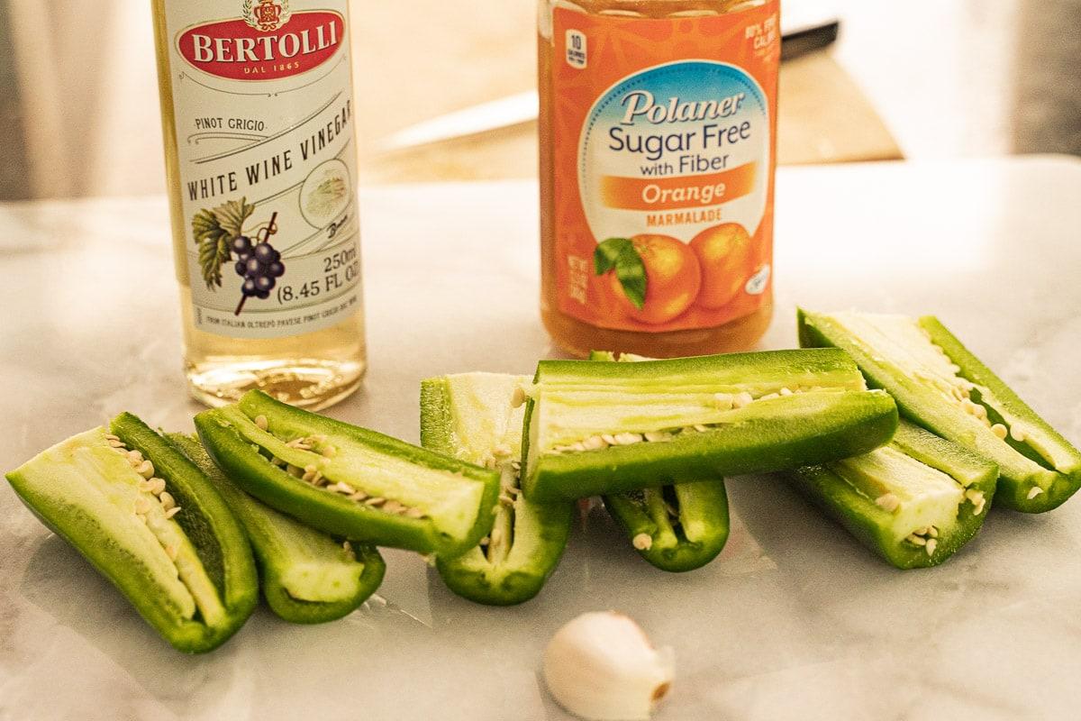sliced jalapenos, orange marmalade, garlic clove, white wine vinegar