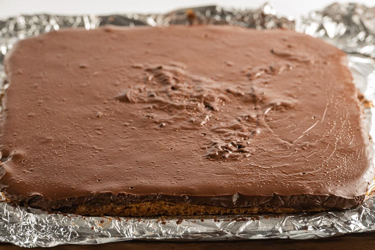 chocolate pudding bars on aluminum foil