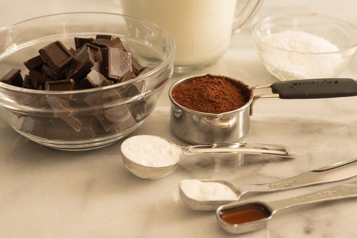 chopped chocolate, cocoa powder, heavy cream, vanilla extract, arrowroot power, sugar substitute