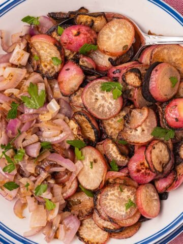 sauteed radishes and onions on plate