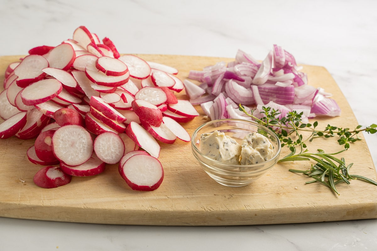 sliced radishes, red onions, basil butter, thyme, rosemary