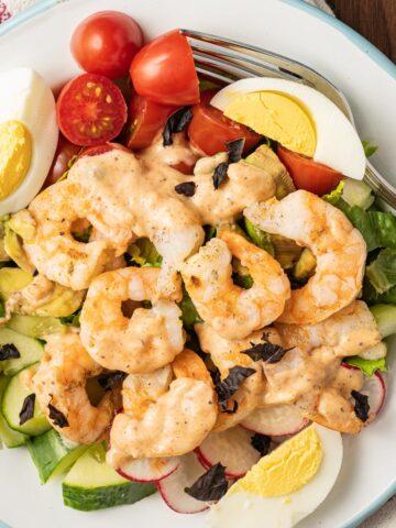 shrimp louie salad on white plate