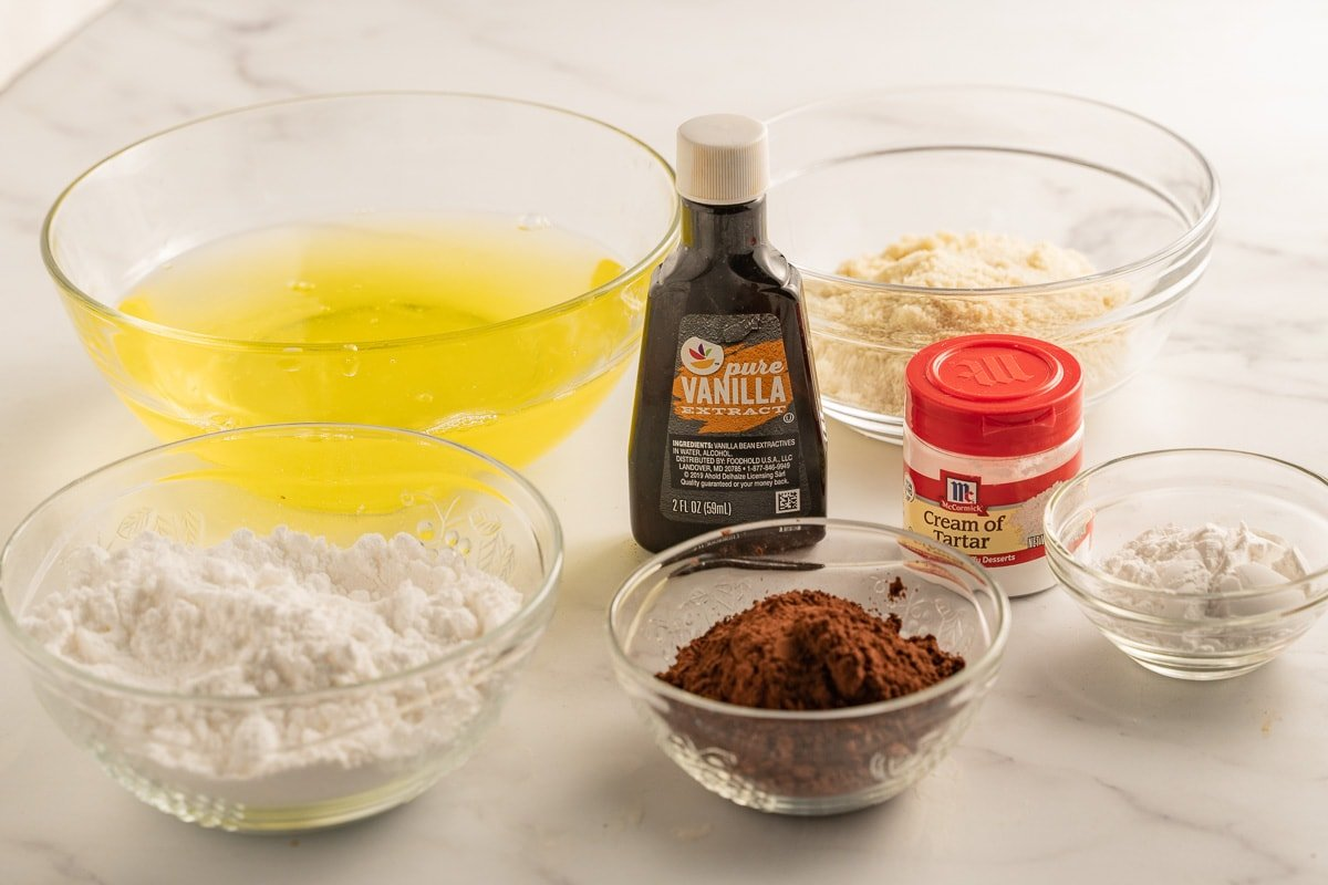 almond flour, powdered sugar, vanilla, cocoa powder, egg whites, cream of tartar