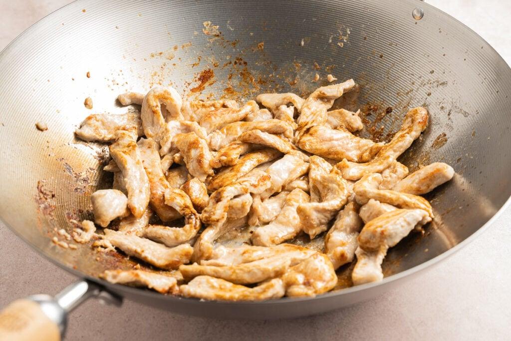 pork tenderloin strips in wok