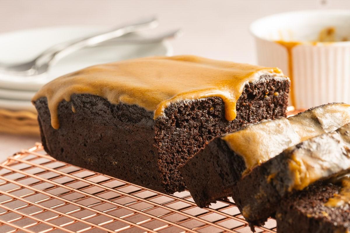 chocolate pumpkin bread with pumpkin glaze on cooling rack
